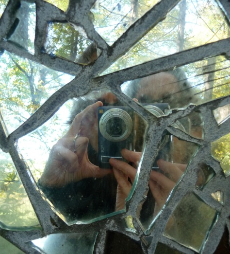 Photo of me taking a photo of myself reflected in a sculpture made of broken mirrors shards